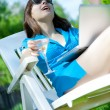 Woman with wineglass laughing — Stock Photo