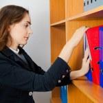 Woman taking a folder — Stock Photo #15710277