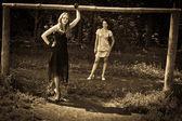 Two women outdoors retro-styled — Stock Photo