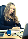 Young businesswoman working — Stock Photo