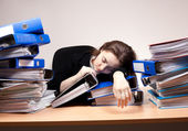 Businesswoman sleeping at office — Stock Photo