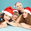 Stock Photo: Four happy women lying on the floor