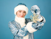 Girl with snowflake — Stock Photo