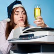 Depressive woman with party hat and a glas off champagne - Stock Photo