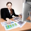 Stock Photo: Businesswomwith financial report