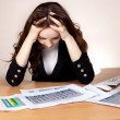 Stock Photo: Frustrated businesswomwith financial report