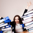 Happy woman with a lot of folders — Stock Photo