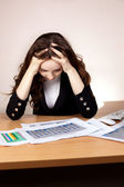 Frustrated businesswoman with financial report — Stock Photo