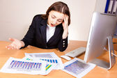 Displeased woman with a financial reports — Stock Photo