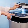 Woman's hand with working copier — Stock Photo #16774275