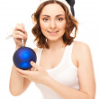 Beautiful woman with christmas toy smiling — Stock Photo