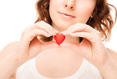 Picture of woman with candy heart — Stock Photo