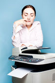 Businesswoman with copier thinking — Stock Photo