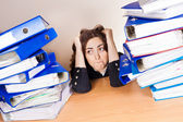 Woman with tons of folders — Stock Photo