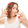 Woman holding heart-shaped cookies — Stock Photo