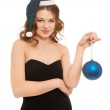 Beautiful woman in black dress smiling with blue new year ball — Stock Photo #17347695