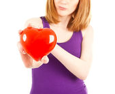 Woman with red heart-shaped jewel box — Stock Photo