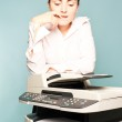 Businesswoman with copier thinking — Stock Photo #18359659