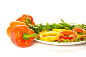 Picture of peppers with palte of parsley — Stock Photo