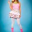 Pin-up woman with colorful lollipop smiling — Stock Photo #18362147
