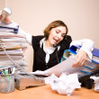 Young businesswoman with tons of documents — Stock Photo #18786567