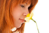 Woman holding yellow narcissus in the hand — Stock Photo