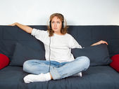 Picture of an attractive young woman listening to music — Stock Photo