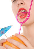 Woman's lips with fruit and pink straw — Stock Photo