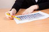 Businesswoman with financial report — Stock Photo