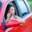 Thoughtful young woman in a car — Stock Photo #22169059