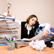 Young businesswoman with tons of documents — Stock Photo #22169479