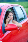 Thoughtful young woman in a car — Stock Photo