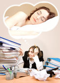 Tired businesswoman with a lot of folders dreaming — Stock Photo