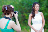 Picture of a woman photographer making a photo — Stock Photo