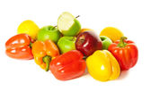 Different fruits and colorful peppers — Stock Photo