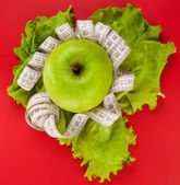 Picture of apple and tape measure — Stock Photo
