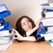 Beautiful businesswoman with a lot of folders — Stock Photo #24979531
