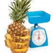 Picture of scale with pineapple — Stock Photo