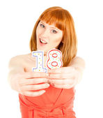 Woman with two candles on the white background — Stock Photo