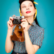 Retro pin-up woman with film camera — Stock Photo