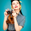 Stock Photo: Retro pin-up woman with film camera