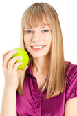Beautiful woman with apple smiling isolated on white — Stock Photo