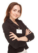 Businesswoman with badge in black jacket isolated — Stock Photo