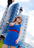 Beautiful woman in blue dress outdoors — Stock Photo