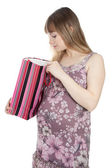 Pregnant woman with shopping bag — Stock Photo