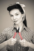 Girl in check shirt with pliers — Foto Stock