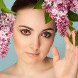 Portrait of beautiful womwith makeup and branch of lilac — Stock Photo #27454521
