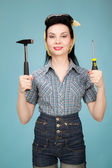 Beautiful pin up woman with hammer and screwdriver — Stock Photo
