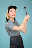 Picture of beautiful pin up woman with hammer — Stock Photo