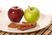 Picture of apples and spices on the white plate (focus on cinnam — Stock Photo